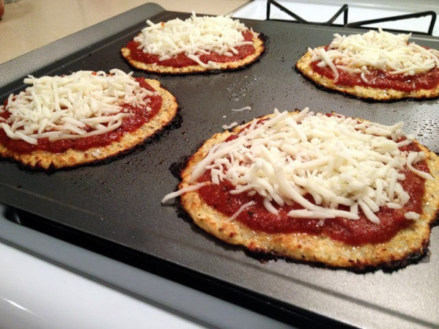 cooked cauliflower crust with tomato sauce and cheese2