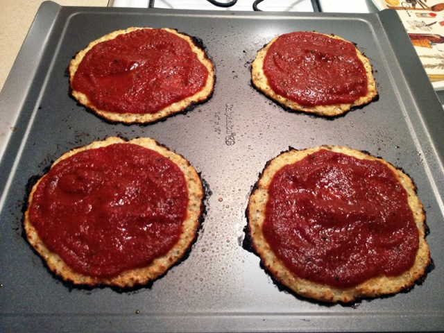 cooked cauliflower crust with tomato sauce