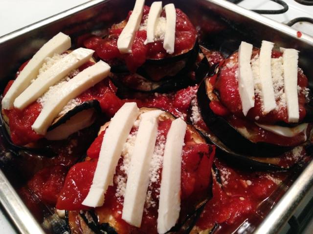 eggplant third layer with tomato sauce, parmesan and mozzarella