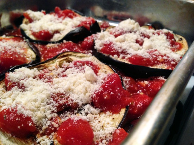 eggplant with tomator sauce and parmesan first layer close up